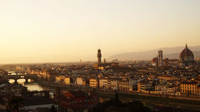 Amazing sunset panorama of Florence with Cathedral of Santa Maria del Fiore, Palazzo Vecchio Palace and Ponte Vecchio Bridge Stock Photography
