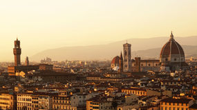 Amazing sunset panorama of Florence with Palazzo Vecchio palace and Cathedral of Saint Mary of the Flower. Santa Maria del Fiore , Florence, Italy Royalty Free Stock Images