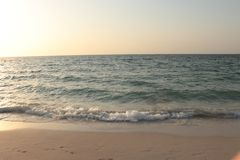 Sunset on the sea. Blue sky. stock image