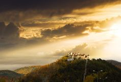Amazing sunset at Rasnov medieval citadel in Transylvania. Rasnov medieval citadel in Transylvania in amazing sunset light surrounded by bright autumn-colored stock photos