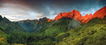 Amazing sunset and red afterglow in high mountains. Splendid alpenglow. Alps, Bavaria, Germany royalty free stock photos