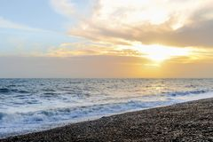 Amazing sunset on the seafront in Brighton beach, Brighton and Hove. Sussex Stock Image