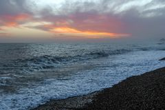 Amazing sunset on the seafront in Brighton beach, Brighton and Hove. Stock Photos