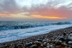 Amazing sunset on the seafront in Brighton beach, Brighton and Hove. Sussex Stock Photo