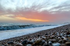 Amazing sunset on the seafront in Brighton beach, Brighton and Hove. Sussex Stock Photos