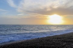 Amazing sunset on the seafront in Brighton beach, Brighton and Hove. Sussex Royalty Free Stock Photo