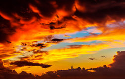 Amazing sunset sky background. Red dramatic cloudscape, overcast weather, sun down, dreamy evening stock photos