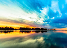 Amazing sunset sky reflection on the river Stock Photo
