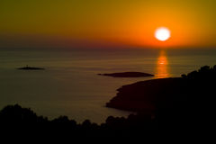 Amazing sunset with small islands. Vis island at sunset in Croatia royalty free stock image