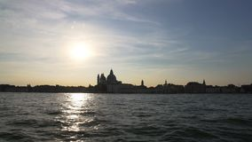 Amazing sunset in Venice, boat cruise on Grand Canal, sightseeing, tourism. Stock footage stock video footage