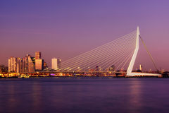 Amazing sunset view of Erasmus bridge and several skyscrapers in Rotterdam, Holland. Stock Photo
