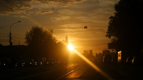 Amazing sunset view on the road in russian city on summer time with lense flare effects Stock Images