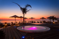 Amazing sunset view from spa area by the beach Royalty Free Stock Photos