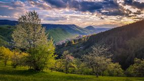 Amazing sunset. View of spring landscapes, sunlight and dark clouds above... stock photography