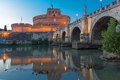 Amazing Sunset view of St. Angelo Bridge and castle st. Angelo in city of Rome, Italy. ROME, ITALY - JUNE 22, 2017: Amazing Sunset view of St. Angelo Bridge and Stock Photography