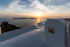 Amazing sunset view from town of Imerovigli to volcano, Santorini island, Thira, Greece Stock Photo