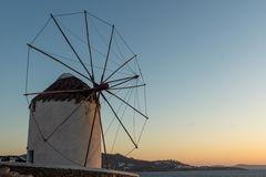 Amazing Sunset and White windmills on the island of Mykonos, Greece Stock Photos