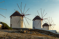 Amazing Sunset and White windmills on the island of Mykonos, Greece Stock Photography