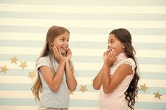 Amazing surprising news. Girls excited expression. Girls kids just heard amazing news. Surprised children excited about. Rumors. Secret little lies or gossips royalty free stock photo