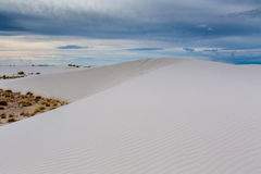 The Amazing Surreal White Sands of New Mexico with Clouds Stock Photo