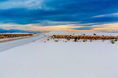 The Amazing Surreal White Sands of New Mexico. The Amazing White Sands of White Sands Monument National Park in New Mexico.  Ominous dark clouds Royalty Free Stock Photography