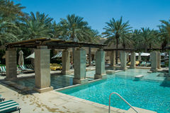 Amazing swimming pool lounge at luxury arabian desert resort Stock Image