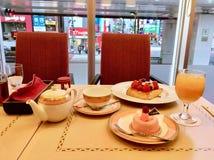 Dessert tea time table cake and mousse. Amazing tea in Tokyo Sakura dessert royalty free stock image