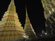 Amazing Thai temples at night Royalty Free Stock Photo