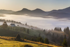 Amazing thick fog in the Carpathian Mountains. Stock Photos
