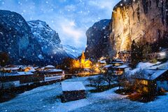 Amazing Touristic Alpine Village At Night In Winter With Famous Church And Staubbach Waterfall  Lauterbrunnen  Switzerland  Europe Royalty Free Stock Image