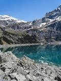Amazing tourquise Oeschinnensee with Swiss Alps Kandersteg stock photography
