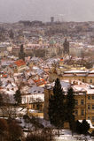 Amazing towers of Charles bridge and old town district during winter day. Heavy snow storm, Prague, Czech republic. Amazing towers of Charles bridge and old town royalty free stock image