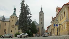 Amazing traditional central european architecture and modern parked cars. On city street in cloudy day stock footage