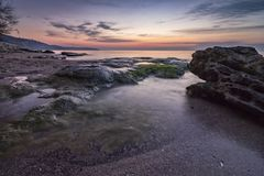 Amazing tranquility sea. And rocky coast before sunrise Royalty Free Stock Images
