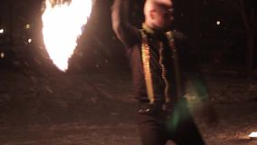 Amazing tribal fire show dance at night on winter under falling snow. Dance group performs with torch lights and. Pyrotechnics stock footage