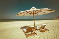 Amazing tropical beach with chairs and umbrella on sand Stock Photography