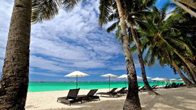 Amazing tropical beach landscape with palm trees. Boracay island, Philippines. Amazing tropical beach landscape with palm trees, umbrellas and chairs for stock footage