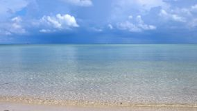 Amazing tropical beach. Ocean waves and cloudy sky background. White sand and crystal-blue sea. slow motion. 3840x2160. Tropical beach. Ocean waves and cloudy stock video
