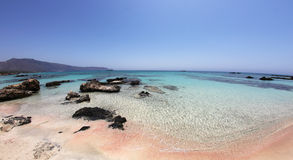 Amazing tropical beach with pink - white sand and turquoise waters. The most awesome beach of Elafonisi Crete Greece. Here you can find pink, white and black Stock Images