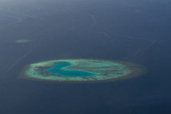 Amazing tropical island at ocean arial view from seaplane at Maldives Stock Images