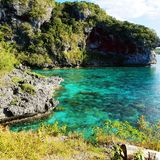 Amazing turquoise water in front of the cliffs of New Caledonia Royalty Free Stock Photo