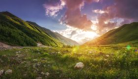 Amazing vibrant landscape of georgian green mountains at sunset with warm sunlight. Panoramic view on beautiful hills in Svaneti stock photos