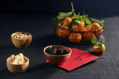 Amazing of Vietnamese food for Tet holiday in spring, tangerine and jam is traditional food on lunar new year, make from jujube. Jam, pumpkin seed, ginger with royalty free stock photos
