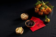 Amazing of Vietnamese food for Tet holiday in spring, tangerine and jam is traditional food on lunar new year, make from jujube. Jam, pumpkin seed, ginger with royalty free stock photography