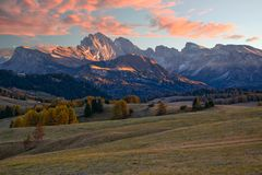 Amazing view of Alpe di Siusi at sunrise. Majestic mountains and colorful sky in background, Dolomite Alps, Italy. Amazing view of Alpe di Siusi - Seiser Alm Stock Image
