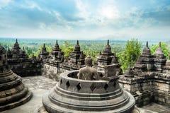 Borobudur temple with meditating Buddha statue. Java, Indonesia royalty free stock photos