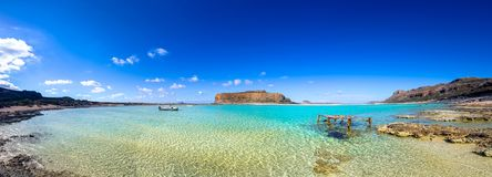 Amazing view of Balos Lagoon with magical turquoise waters, lagoons, tropical beaches of pure white sand and Gramvousa island. Royalty Free Stock Image