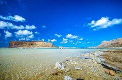Amazing view of Balos Lagoon with magical turquoise waters, lagoons, tropical beaches of pure white sand and Gramvousa island. Royalty Free Stock Photos