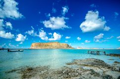 Amazing view of Balos Lagoon with magical turquoise waters, lagoons, tropical beaches of pure white sand and Gramvousa island. Stock Image