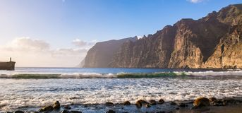 Amazing view of beach in Los Gigantes with high cliffs on the su. Nset. Location: Los Gigantes, Tenerife, Canary Islands. Artistic picture. Beauty world Stock Photo